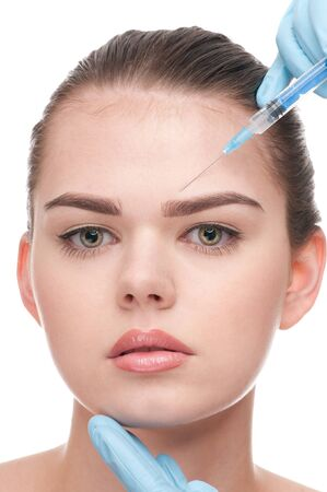cosmetic injection of botox to the face of beautiful woman - close-up portrait isolated on white Stock Photo - 8516599