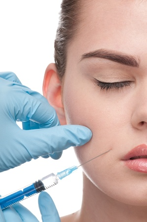 botox: cosmetic injection of botox to the face of beautiful woman - close-up portrait isolated on white
