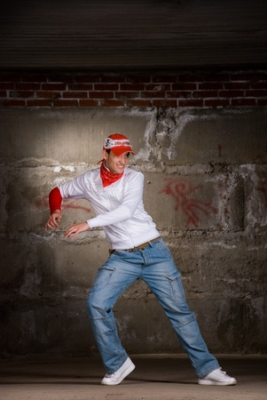 Hip hop men dancing in modern style over grey brick wall Stock Photo - 8516373