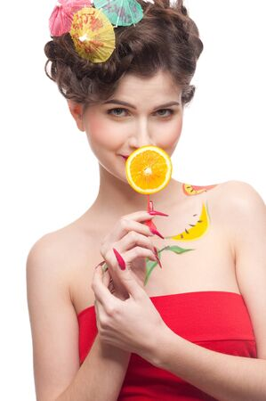 Close up portrait of young beauty woman with fruit bodyart and piece of juicy orange . Isolated on white. photo