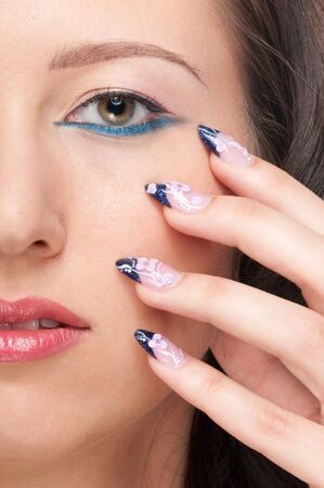 Close-up portrait of beauty woman face with perfect skin. Nail art Stock Photo - 8571212