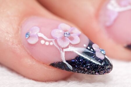 Closeup hands nail art zone. Pink and blue with jewel. High resolution. Stock Photo - 8571558