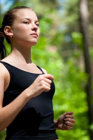 Woman run in forest Stock Photo - 10524280