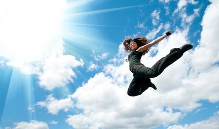 stunts: Jump over sun Stock Photo