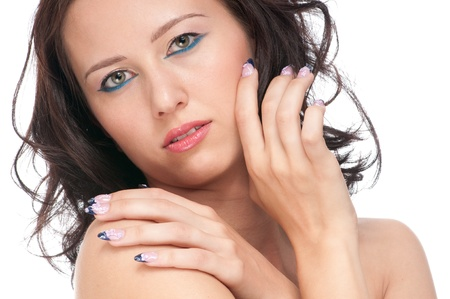 Close-up portrait of beauty woman face with perfect skin. Nail art photo