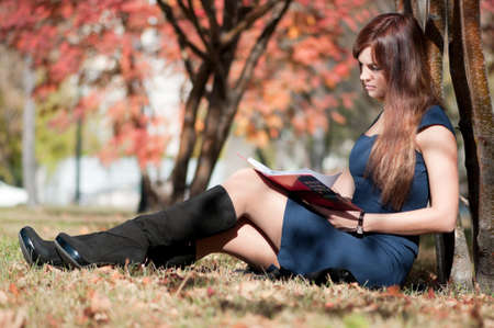 Young business woman planing, writing and reviewing  diary at city park. Student Stock Photo - 8715610