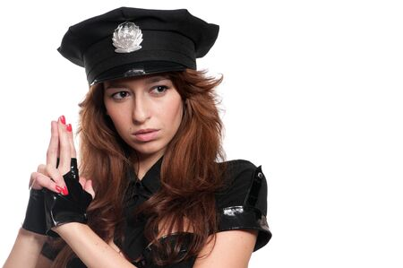 Young beautiful police woman posing in sexy costume isolated on white Stock Photo - 8714895