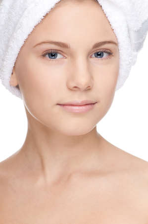Closeup portrait of young beautiful girl with perfect skin and towel on head. Visage. Isolated on white Stock Photo - 8715810