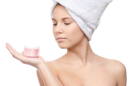 Closeup of young beautiful girl with perfect skin offering cream Stock Photo - 8715772
