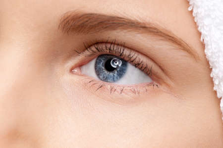 Close-up shoot of young beautiful girl with perfect skin: blue eye makeup zone. Macro photo