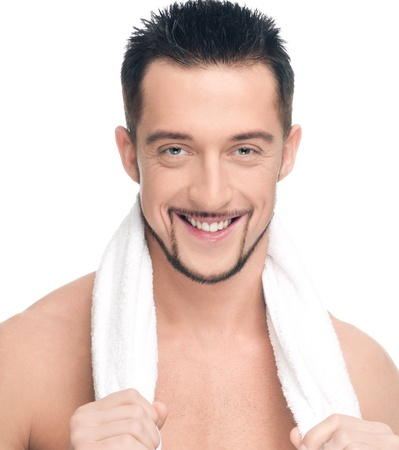Close up portrait of young happy man face with perfect skin and towel. Isolated on white Stock Photo - 8715775