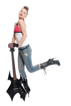 Portrait of beautiful young rock woman with black electric guitar. Isolated on white photo