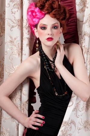 Closeup portrait of beautiful fashion woman posing with silck fabric. Stock Photo - 8830194
