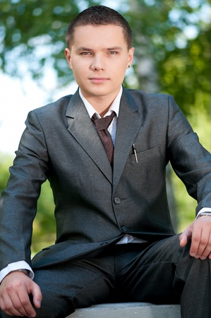 Young business man waiting for meeting at green park. Student. Stock Photo - 8829788