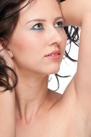 Close-up portrait of beauty woman face with perfect skin and blue makeup photo