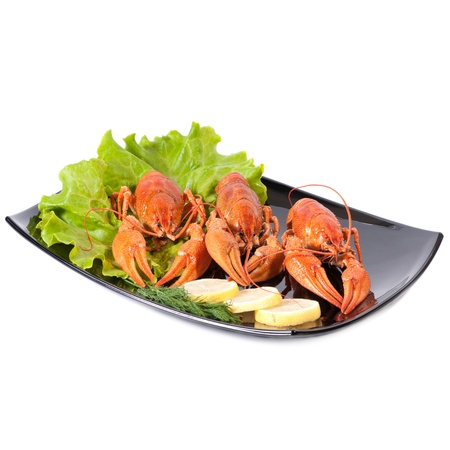 Plate of red boiled lobsters with fresh lettuce. Luxury diet meal photo