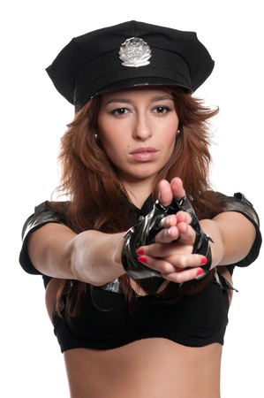 Young beautiful police woman posing in sexy costume isolated on white Stock Photo - 8877496
