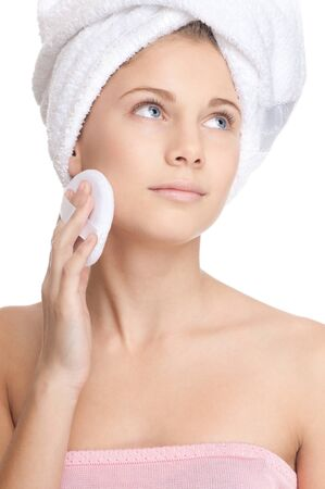 Closeup shoot of young beautiful girl with perfect skin apply cosmetic sponge photo