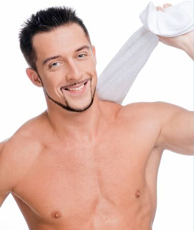 Close up portrait of young happy man face with perfect skin and towel. Isolated on white Stock Photo - 8948958