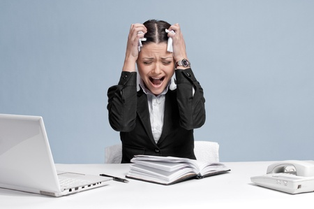 bad plan: Sad business woman in office working with white table, laptop and diary personal organizer. Problem!