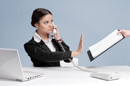 no person: Busy business woman in office talking by phone and sign a papers at work place. Stict! Not now! Stock Photo