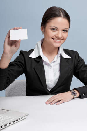 Emotional business woman in office palce show white personal card. Smile photo