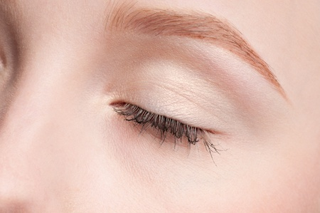 Close-up face of beauty young woman - eye make-up zone photo