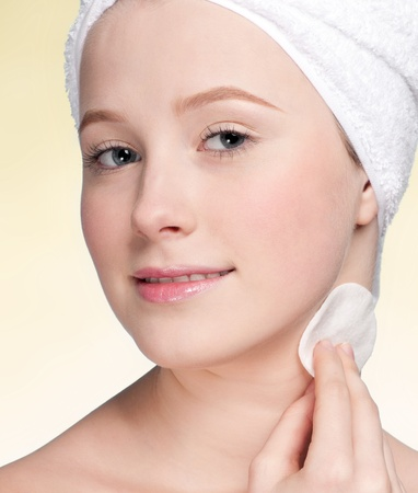Close-up face of beauty young woman applying sponge photo