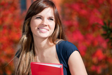 Young beautiful business woman hoding diary at city park. Student Stock Photo - 9109166