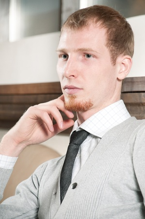 Sure young business man in office rest room  interior Stock Photo - 9109193