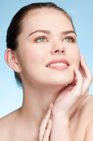 Close-up portrait of young adult woman with perfect health skin of face Stock Photo - 9109169