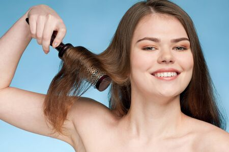 Close up portrait of young beautiful woman that comb perfect hair Stock Photo - 9109171