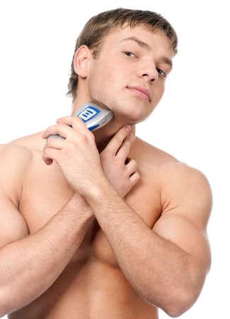 hombre afeitandose: Retrato de un hombre guapo rasurado como parte de su routin de ma�ana