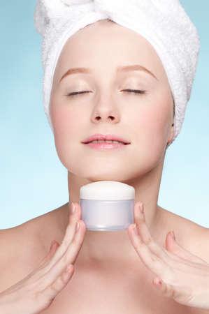 Beautiful woman tender jar of moisturizer cream. Close-up fresh young woman face Stock Photo - 9186175