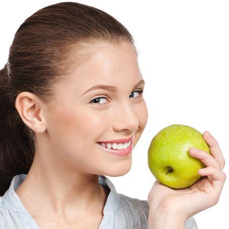 Young Beauty Woman mit grünem Apfel, isoliert auf weiss Standard-Bild