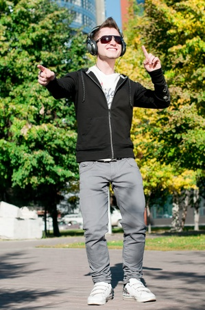 young casual cheerful man dancing outdoor in city park Stock Photo - 9221269