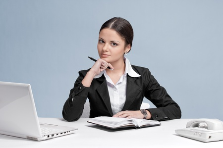 Casual business woman in office working with white table, laptop and diary personal organizer. Idea! photo