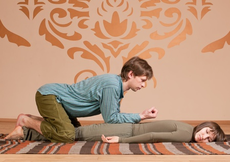 lesure: Two young man and woman couple doing yoga. Massage Stock Photo