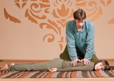 Two young man and woman couple doing yoga. Massage Stock Photo - 9292385