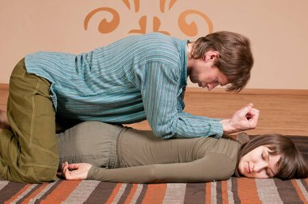Two young man and woman couple doing yoga. Massage Stock Photo - 9292462