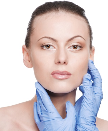 Beautician touch and exam health woman face. Plastic surgery. Isolated Stock Photo - 9339141