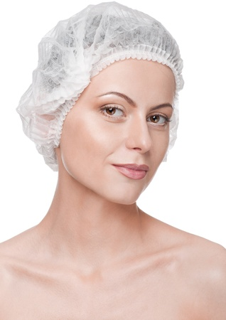 Beautician touch and exam health woman face. Plastic surgery. Isolated Stock Photo - 9339164