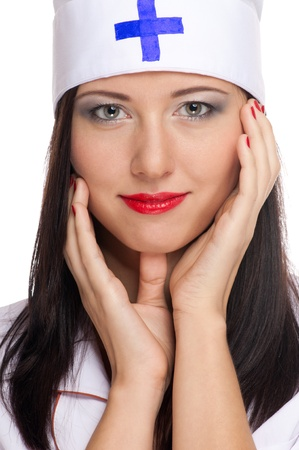 Closeup portrait of beautyful sexy  medic woman with red lips and uniform. Isolated on white photo