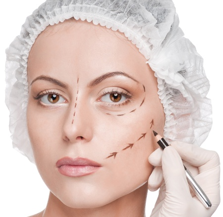 plastic surgeon: Beautician touch and draw correction lines on woman face. Before plastic surgery operetion. Isolated Stock Photo
