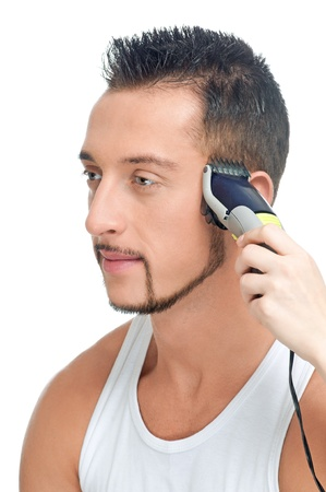 Close up portrait of young handsome man with perfect skin and hair. Cutting hairs. Stock Photo - 9452768