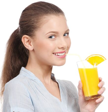 Pretty young woman with glass of orange juice isolated on the white background photo