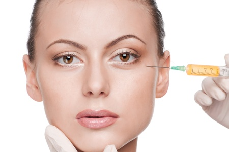 Cosmetic botox injection in the female face. Eye zone. Isolated Stock Photo - 9566382