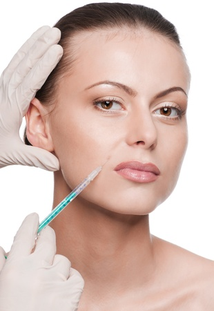 Cosmetic botox injection in the female face. Lips zone. Isolated Stock Photo - 9566388
