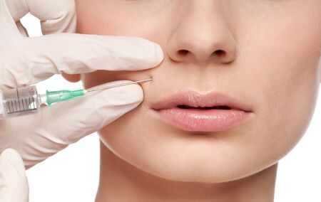 Cosmetic botox injection in the female face. Lips zone, Isolated Stock Photo