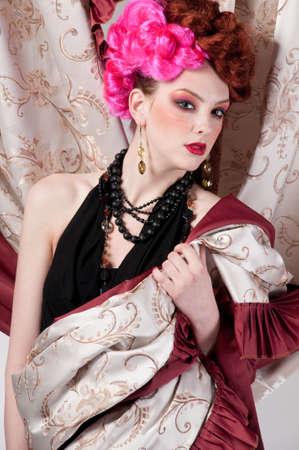Closeup portrait of beautiful fashion woman posing with silck fabric. Stock Photo - 9633261